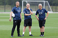 Pictured: (L-R) Martyn Margetson, goalkeeping and set piece coach for Swansea City, Steve Cooper Head Coach of Swansea City and Mike Marsh, assistant first team coach for Swansea City during the Swansea City FC training session at the Fairwood training ground in Swansea, Wales, UK Saturday 29 June 2019Saturday 29 June 2019<br /> Re: Swansea City FC training, Fairwood, near Swansea, Wales, UK