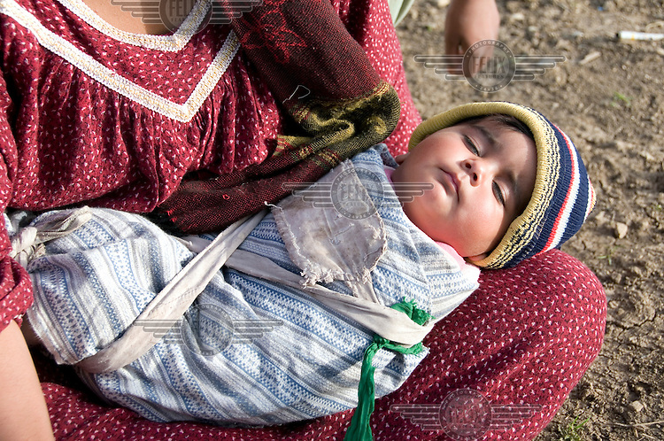 Shema Hussain Yasim with her baby Roqaia at the Qawala camp for displaced persons, where 136 families from accross the country are housed.