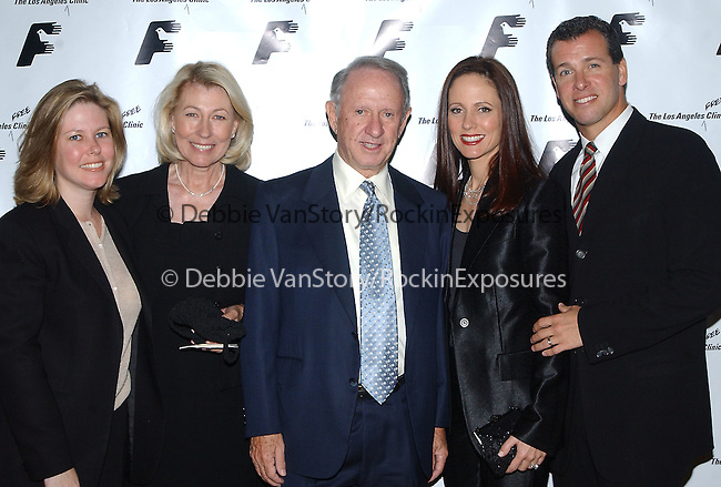 20th Century Fox President Dana Walden with her family at the Los Angeles Free Clinic Dinner Gala  at The Regent Beverly Wilshire Hotel in Beverly Hills ,California on December 2,2002.Photo by Hollywood Press Agency