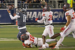 """Nevada quarterback Carson Strong (12) fumbles as he is hit by New Mexico linebacker Alexander """"Moana"""" Vainikolo (30) in the first half of an NCAA college football game in Reno, Nev., Saturday, Nov. 2, 2019. (AP Photo/Tom R. Smedes)"""