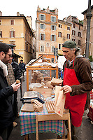 Vendor selling freshly baked bread from biodynamic wheat and grains, Rome, Italy