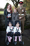 © Joel Goodman - 07973 332324 . 09/11/2014 .  Salford , UK . Mother Tina Robinson , daughter Eloise Hughes (ten) , father Pete Robinson and twin daughters Pheobie and Skyla Robinson (two) (all correct) . Remembrance Sunday memorial service at the cenotaph in front of Salford Town Hall in Swinton . Photo credit : Joel Goodman
