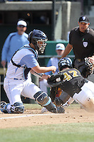 Jacob Stallings, #5, of the North Carolina Tar Heels tags out a runner at the plate against the Missouri Tigers at Dedeaux Field on February 20, 2011 in Los Angeles,California. Photo by Larry Goren/Four Seam Images