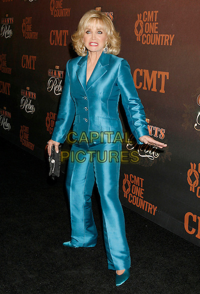 "BARBARA MANDRELL.Arrivals at ""CMT Giants"" Honoring Reba McEntire held at the Kodak Theatre, Hollywood, LA, California, USA,.26 October 2006..full length blue trouser suit funny hands arms.Ref: ADM/RE.www.capitalpictures.com.sales@capitalpictures.com.©Russ Elliot/AdMedia/Capital Pictures."