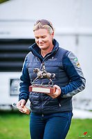 Christine Weal presents the trophy to: NZL-Lucarne Dolley rides Ardmore during the Prizegiving for the Emmerson Transport CDIY FEI Young Rider Freestryle (Title). Final-1st. 2018 NZL-Horse of the Year Show. Hastings. Sunday 18 March. Copyright Photo: Libby Law Photography