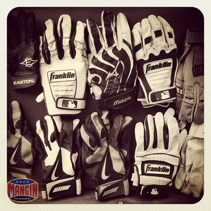 OAKLAND, CA - AUGUST 4: Instagram of Franklin, Mizuno, Easton, and Nike batting gloves belonging to the Tampa Bay Rays sit in the dugout before the game against the Oakland Athletics at O.co Coliseum on August 4, 2014 in Oakland, California. Photo by Brad Mangin
