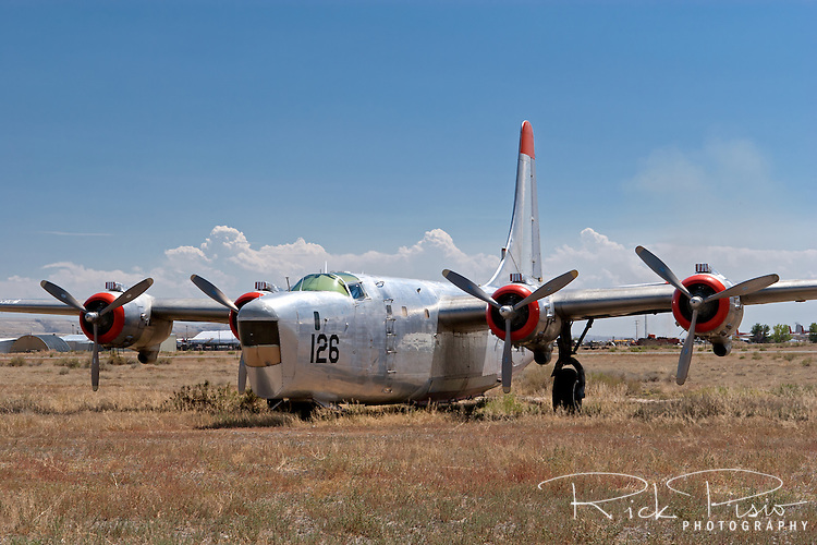 Hawkins &amp; Powers PB4Y Privateer sitting in the Hawkins and Powers storage area. BuNo. 59882, N7962C, is a PB4Y-2. Hawkins and Powers used a number of Privateers for aerial firefighting.<br /> <br /> The PB4Y-2 Privateer was based on the B-24N Liberator with modifications specified by the Navy for a patrol bomber. The most noteable difference is the tail section. The PB4Y also did not have turbocharged engines since its role as a patrol bomber did not require it to operate at the altitudes that the B-24 did.