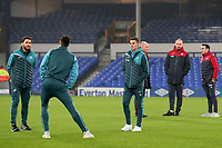 Swansea City players and back room staff inspect the pitch prior to kick-off in the Premier League match between Everton and Swansea City at Goodison Park, Liverpool, England, UK. Monday 18 December 2017