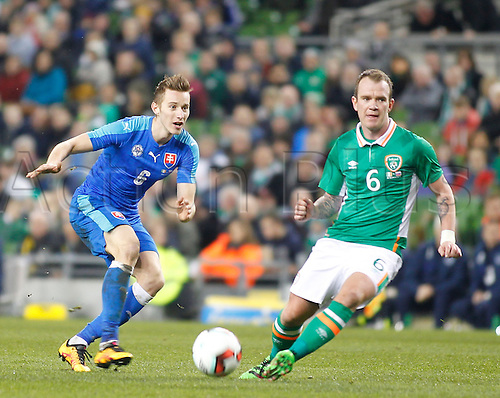 29.03.2016. Aviva Stadium, Dublin, Ireland.  International Football Friendly Ireland versus Slovakia. Jan Gregus (Slovakia) gets past Glen Whelan (Rep. of Ireland).