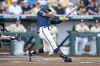 Michigan Wolverines outfielder Christian Bullock (5) swings the bat against the Vanderbilt Commodores during Game 3 of the NCAA College World Series Finals on June 26, 2019 at TD Ameritrade Park in Omaha, Nebraska. Vanderbilt defeated Michigan 8-2 to win the National Championship. (Andrew Woolley/Four Seam Images)