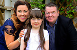 16/05/2015 - Mell Communion – Caitlín Donaghy with her parents Brian and Tina. Picture: www.newsfile.ie