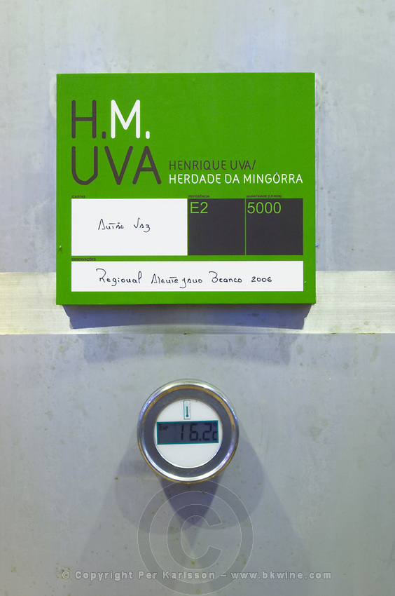 Fermentation tanks. Sign saying Antao Vaz grapes. Thermometer showing 16.2 Centigrade. Henrque HM Uva, Herdade da Mingorra, Alentejo, Portugal