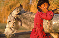 Syria, ..Donkey and girl...Photo Kees Metselaar