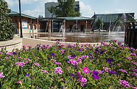 NWA Democrat-Gazette/BEN GOFF @NWABENGOFF<br /> Flowers decorate one of the entrances to the splash pad Wednesday, Sept. 4, 2019, at Lawrence Plaza in downtown Bentonville. Bentonville Parks and Recreation plans to hold a public input meeting for the downtown parks master plan 6:00 p.m. Monday, Sept. 16 at the Bentonville Public Library.