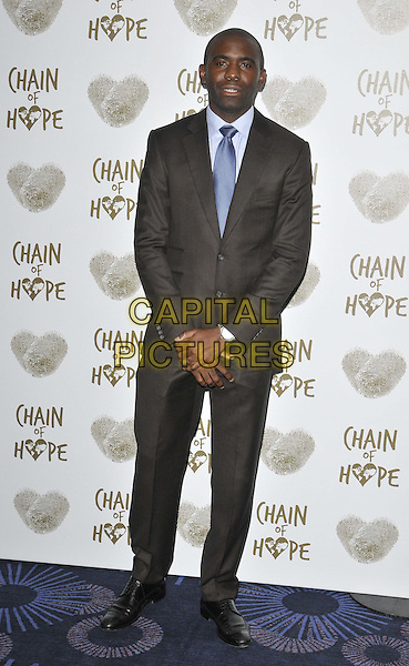 LONDON, ENGLAND - NOVEMBER 21: Fabrice Muamba attends the Chain Of Hope Ball, Grosvenor House Hotel, Park Lane, on Friday November 21, 2014 in London, England, UK. <br /> CAP/CAN<br /> &copy;Can Nguyen/Capital Pictures