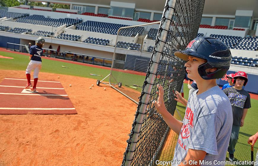 Jack Ketchum waits to bat during the Ole Miss baseball camp. Photo by Thomas Graning/Ole Miss Communications