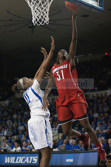 Louisville Cardinals forward Asia Taylor (31) lays up the ball over Kentucky Wildcats forward DeNesha Stallworth (11) during the first half of the University of Kentucky vs. University of Louisville women's basketball game at Memorial Coliseum in Lexington, Ky., on Sunday, December 1, 2013. Kentucky defeated Louisville 69-64.Photo by Michael Reaves | Staff