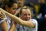 Berlin, Germany, February 01: (L-R) Selin Oruz #14 of Duesseldorfer HC and Jenny Froehlich #8 of Duesseldorfer HC celebrate after winning the 1. Bundesliga Damen Hallensaison 2014/15 final hockey match between Duesseldorfer HC (white) and HTC Uhlenhorst Muehlheim (green) on February 1, 2015 at the Final Four tournament at Max-Schmeling-Halle in Berlin, Germany. Final score 4-1 (1-0). (Photo by Dirk Markgraf / www.265-images.com) *** Local caption ***