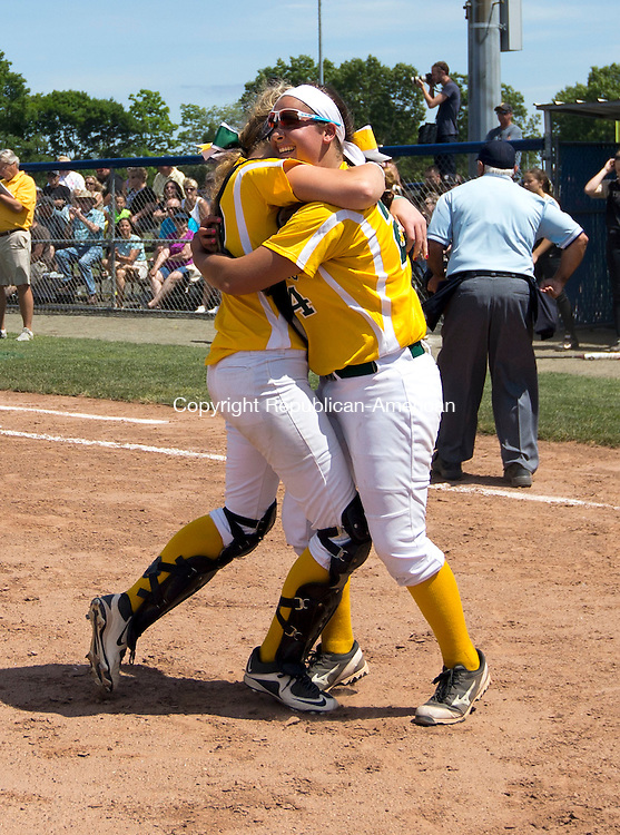 West Haven, CT- 13 June 2015-061315CM14-   Holy Cross' Sarah Lawton, right, and catcher Paige Hine celebrate following a 4-0 win over Thomaston to capture the Class S state softball title in West Haven on Saturday.  Christopher Massa Republican-American