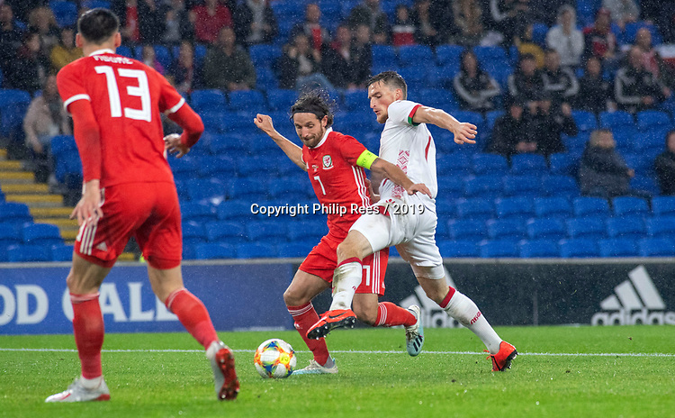 Cardiff - UK - 9th September :<br />Wales v Belarus Friendly match at Cardiff City Stadium.<br />Wales Captain Joe Allen is tackled by Evgeni Yablonski in the first half.<br />Editorial use only