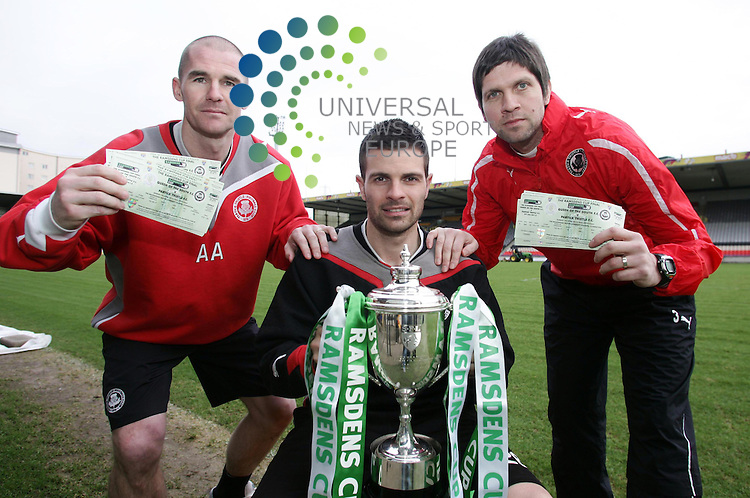Ramsdens Cup Final ticket Sale.Thursday 7th Feb 2013.Firhill Stadium .Interim Jags  Manager Alan Archibald and Coach Scott Patterson with winning semi-Final scorer Steven Craig promote the public sale of the Cup Final tickets for the game against Queen of the South at Livingston on April 7th..Photo by Tommy Taylor Universal News and Sport
