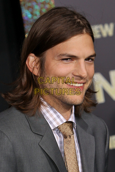 "Ashton Kutcher.The World Premiere of ""New Year's Eve' held at The Grauman's Chinese Theatre in Hollywood, California, USA..December 5th, 2011.headshot portrait grey gray suit jacket stubble facial hair check shirt white yellow tie.CAP/CEL .©CelPh/Capital Pictures."