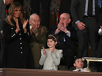 Grace Eline, who was diagnosed with Germinoma, a germ-cell brain tumor, applauds after being introduced by United States President Donald J. Trump during his second annual State of the Union Address to a joint session of the US Congress in the US Capitol in Washington, DC on Tuesday, February 5, 2019.  Grace recently finished chemotherapy and currently shows no evidence of the disease.  First lady Melania Trump applauds at left.  Joshua Trump, a sixth grader who was bullied at school because of his last name is pictured at right.<br /> Credit: Alex Edelman / CNP/AdMedia