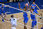 LOS ANGELES - MAY 5:  Daenan Gyimah #16 and Jake Arnitz #15 of the UCLA Bruins defends against Kyle Ensing #5 of the Long Beach State 49ers during the Division 1 Men's Volleyball Championship on May 5, 2018 at Pauley Pavilion in Los Angeles, California. The Long Beach State 49ers defeated the UCLA Bruins 3-2. (Photo by John W. McDonough/NCAA Photos via Getty Images)