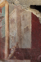 Fresco decoration of buildings painted using perspective techniques, in the Frigidarium or cold pool of the baths in the Casa del Criptoportico, or House of the Cryptoporticus, Pompeii, Italy. This room is decorated in the Second Style of Pompeiian wall painting, 1st century BC. The house is one of the largest in Pompeii and was owned by the Valerii Rufi family and built in the 3rd century BC. It takes its name from the underground corridor or cryptoporticus used as a wine cellar and lit by small windows. Pompeii is a Roman town which was destroyed and buried under 4-6 m of volcanic ash in the eruption of Mount Vesuvius in 79 AD. Buildings and artefacts were preserved in the ash and have been excavated and restored. Pompeii is listed as a UNESCO World Heritage Site. Picture by Manuel Cohen