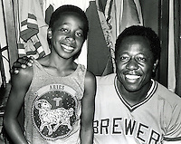 "Stanley Burrell (AK M.C. Hammer) with slugger Hank AAron. Players called Burrell ""little Hammer"" because of his look-alike. Burrell went on to entertainment  career as M. C. Hammer. (photo 1975 copyright Ron Riesterer)"