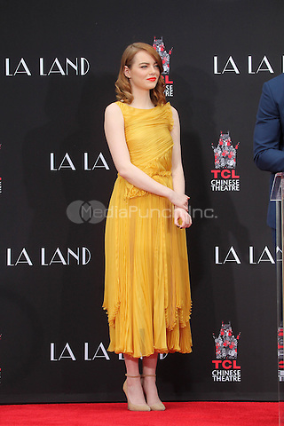 HOLLYWOOD, CA - DECEMBER 7: Emma Stone  at the Emma Stone and Ryan Gosling Hand and Foot Print Ceremony at the TCL Chinese Theater in Hollywood, California on December 7, 2016. Credit: David Edwards/MediaPunch