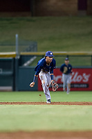 AZL Brewers shortstop Yeison Coca (7) flips a ball to second baseman Francisco Thomas (not pictured) during a game against the AZL Cubs on August 6, 2017 at Sloan Park in Mesa, Arizona. AZL Cubs defeated the AZL Brewers 8-7. (Zachary Lucy/Four Seam Images)