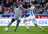 Lincoln City's John Akinde battles with Huddersfield Town's Jon Gorenc Stankovic<br /> <br /> Photographer Andrew Vaughan/CameraSport<br /> <br /> The Carabao Cup First Round - Huddersfield Town v Lincoln City - Tuesday 13th August 2019 - John Smith's Stadium - Huddersfield<br />  <br /> World Copyright © 2019 CameraSport. All rights reserved. 43 Linden Ave. Countesthorpe. Leicester. England. LE8 5PG - Tel: +44 (0) 116 277 4147 - admin@camerasport.com - www.camerasport.com