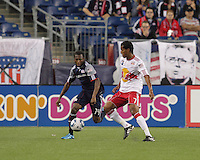 New England Revolution midfielder Sainey Nyassi (14) brings the ball out of the defensive half as New York Red Bulls defender Roy Miller (7) defends. The New England Revolution defeated the New York Red Bulls, 3-2, at Gillette Stadium on May 29, 2010.