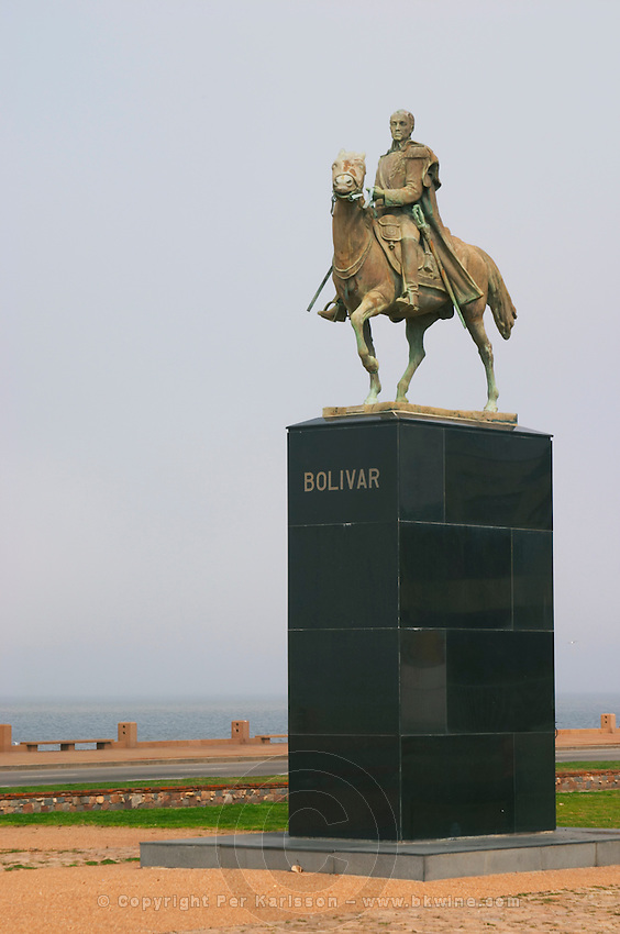 Statue of Bolivar El Libertador, The Liberator, sitting on a horse on a black marble pedestal., on the riverside seaside walk along the river Rio de la Plata Ramblas Sur, Gran Bretagna and Republica Argentina Montevideo, Uruguay, South America