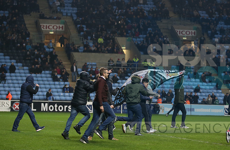 Coventry fans invade the pitch and stop play during the English League One match at the Rioch Arena Stadium, Coventry. Picture date: December 15th, 2016. Pic Simon Bellis/Sportimage