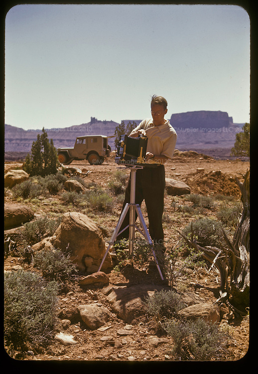 "After he finished school in LA and before he settled down in the Black Hills of South Dakota, Don Mueller went into the desert. He and his pal Don McKenzie had their camera gear, a jeep, supplies and sunglasses. The excursion into the sandstone arches of Utah and the cacti smattered deserts of Arizona, was known only as, ""ex-pe-di-teeon Moab."" After a brief stint in landscape and tourism photography, and many days spent in the hot desert sun, the young men called it quits and moved on to greener pastures."