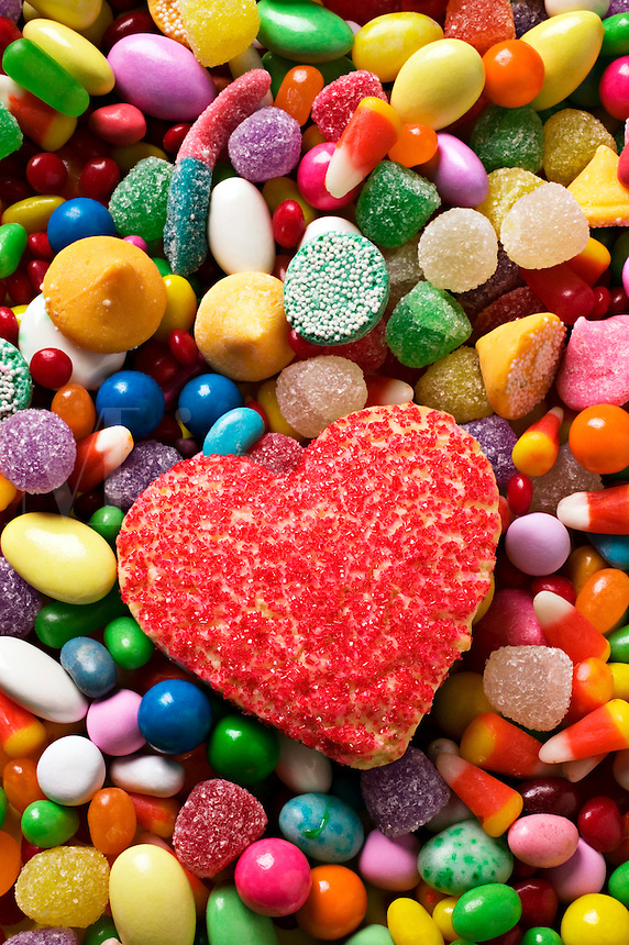Heart shaped cookie on assorted candy