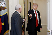 United States President Donald Trump talks to US Vice President Mike Pence while leaving the Oval Office of the White House March 31, 2017 in Washington, DC. Photo Credit: Olivier Douliery/CNP/AdMedia