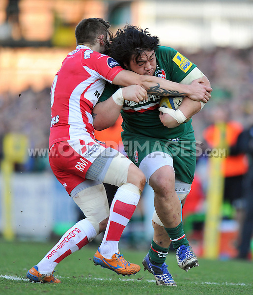 Logovi'i Mulipola is tackled in possession. Aviva Premiership match, between Leicester Tigers and Gloucester Rugby on February 16, 2014 at Welford Road in Leicester, England. Photo by: Patrick Khachfe / JMP
