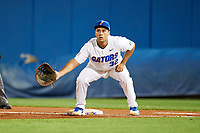 Florida Gators first baseman Keenan Bell (32) holds a runner on during a game against the Siena Saints on February 16, 2018 at Alfred A. McKethan Stadium in Gainesville, Florida.  Florida defeated Siena 7-1.  (Mike Janes/Four Seam Images)