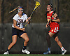 Ashley Lynch #9 of Cold Spring Harbor, left, gets pressured by Audrey Mandaro #9 of Sacred Heart during a non-league varsity girls lacrosse game at Cold Spring Harbor High School on Friday, Apr. 1, 2016. Lynch tallied nine points (four goals, five assists) in Cold Spring Harbor's 11-9 win.