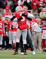 Ohio State Buckeyes defensive back Corey Brown (3) hugs Ohio State Buckeyes head coach Urban Meyer during  senior day before the start of their game against Indiana Hoosiers at Ohio Stadium in Columbus, Ohio on November 23, 2013.  (Dispatch photo by Kyle Robertson)