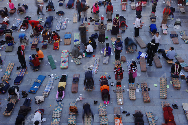 A Tibetans prayed and prostrated themselves in front of the entrance of the Jokhang, the central cathedral of Tibetan Bhuddism, in the capital Lhasa. November 14, 2006