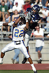 Nevada reciever Nate Burleson goes over San Jose State defender Melvin Cook for a touchdown reception late in the third quarter of Saturday's game, Oct. 19, 2002, in Reno, Nev..Photo by Cathleen Allison