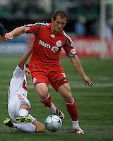 16 May 09: Chicago Fire midfielder John Thorrington #11 slide tackles Toronto FC forward Chad Barrett #19  at BMO Field during a game between the Chicago Fire and Toronto FC..Chicago Fire won 2-0..