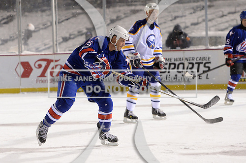 Randy Cunneyworth (15) during The Frozen Frontier Buffalo Sabres vs. Rochester Amerks Alumni Game at Frontier Field on December 15, 2013 in Rochester, New York.  (Copyright Mike Janes Photography)