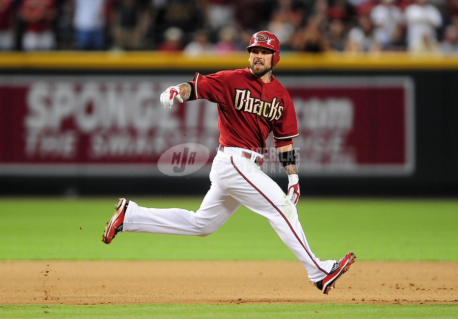 Aug. 11, 2009; Phoenix, AZ, USA; Arizona Diamondbacks base runner Ryan Roberts against the New York Mets at Chase Field. Mandatory Credit: Mark J. Rebilas-