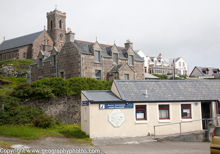 Tourist Information office, houses, hotel and church in Castlebay, Barra, Outer Hebrides, Scotland, UK