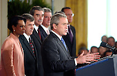 Washington, D.C. - August 2, 2005 --  United States President George W. Bush signs the Central America Free Trade Agreement (CAFTA) during a ceremony in the East Room of the White House in Washington, D.C. on August 2, 2005.  The agreement, between the United States and Costa Rica, El Salvador, Guatemala, Honduras, Nicaragua and the Dominican Republic, removes trade barriers and opens up the region to American goods and services. It also moves to facilitate investment in the area and strengthens protections for intellectual property.  It barely passed the House of Representatives by a 217 to 215 vote.  From left to right: United States Secretary of State Condoleezza Rice; United States Secretary of Agriculture Mike Johanns; United States Secretary of Commerce Carlos Gutierrez; Ambassador Tomas Duenas of Costa Rica; The President; Ambassador Flavio Dario Espinal of the Dominican Republic (partially obscured); and Ambassador Rene Leon of El Salvador.<br /> Credit: Ron Sachs / CNP